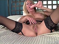 Experienced porn actress Erica Lauren puts on lace lingerie and has fun with toy 7