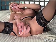 Experienced porn actress Erica Lauren puts on lace lingerie and has fun with toy 8