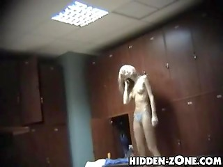 Girls and women who get dressed after taking shower are recorded on hidden camera set in the locker room