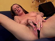 Mature whore teases her smooth-shaved cunt with manicured fingers being in proud loneliness 4