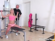 Bearded old man finished doing exercises instantly when young blonde entered the gym 3
