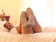 Girl in striped knee socks masturbates her pussy tenderly and gets off by that touches 3