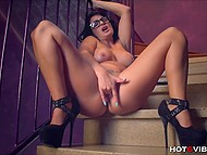 Black-haired babe with glasses was filming herself while was polishing neat cunny with vibrating ring 8