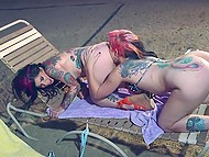 Two tattooed girlfriends heat their beddable trimmed peaches on the beach 11