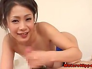 Sweet Japanese gives blowjob to her boyfriend in sexy way meekly smiling at him