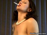 Woman smokes cigarette masturbating pussy and bares some of her body parts 3