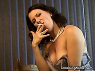 Woman smokes cigarette masturbating pussy and bares some of her body parts 4