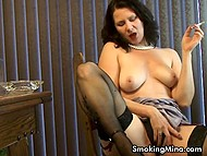 Woman smokes cigarette masturbating pussy and bares some of her body parts 8