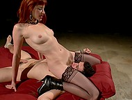 Obedient slave waits for his fiery-red mistress in corset to get fucked in asshole with strapon 9