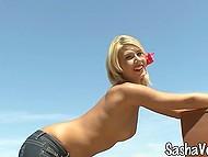 Endless landscape stretches behind posing naked blonde model Sasha Von  6