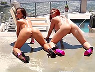 Twerking presented in the performance of two seductive cuties in resort town hotel pool 5