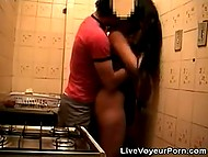 Male turned on the camera to record classy brunette giving him a head in kitchen 9