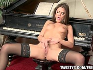 Little Caprice's little fingers perfectly push piano keys as well as caress tiny clit