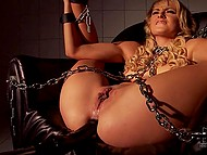 Chained blonde at first resisted the black dildo, but when it entered her pussy, she lost her mind 9