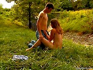 Red-haired chick with her boyfriend get in nature to have oral sex in the open air 4