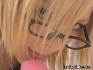 Elegant Jessica Cute with glasses and in fishnet stockings takes pleasure in playing with sex toy