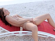 Sweet thing laid down on sun lounger and fingered neat pussy on the deserted beach 10