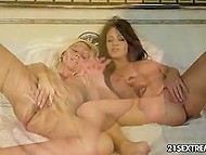 Two lovely chicks indulge their passion and make love peeing on each other in the end 9
