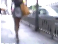 There are a lot of Asian girls walking around the city and pervert with camera tries to look up their skirts 11