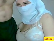 Muslim girl hides her face while is masturbating and fondling boyfriend's penis on webcam 8