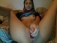 Appealing Arab with hijab keeps legs widely opened while is shoving dildo inside pussy on webcam 3