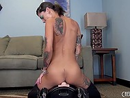 Tattooed brunette rubbed pussy with fingers and sat down on fucking machine 5