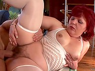 Mature lady with red hair was watching porn when young chaser came to poke her 9