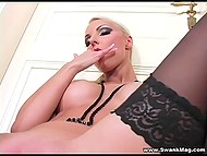 Big-boobied blonde with makeup shoves manicured fingers inside smooth-shaven cunny 7