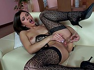 Seductive brunette in sexy stockings brings herself to orgasm masturbating smooth peach with glass dildo 10