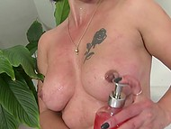 Mature lady with rose tattoo on left chest amused shaved sissy with shower flow and dildo 8