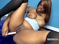 Hearty chocolate is tenderly massaging narrow pussy with her small versatile vibrator 9