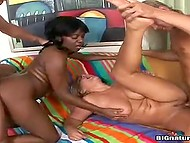 Attractive blonde with black girlfriend were oiled and penetrated in the group sex scene 9
