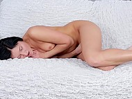 Dark-haired babe was relaxing by rubbing clitoris with gentle fingers and not listening music 9