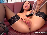 Before bringing vibrator and dildo into play, lustful brunette in high heels had fun with vaginal pump 4