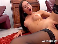 Before bringing vibrator and dildo into play, lustful brunette in high heels had fun with vaginal pump 7