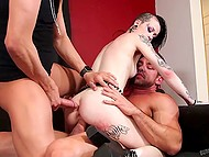 Two muscled guys have fun with brutal dark-haired chick fucking all her sweet holes 8