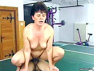 Old lady and young German sportsman had great sexual workout in the gym