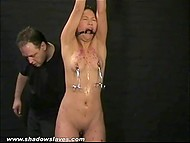Master had put clothespins on Asian's small tits and poured hot wax on her body but she could handle it 9