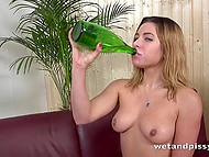 Mischievous babe filled glass bottle with own urine and drank it like sparkling wine 11