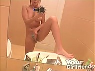 Lass with succulent melons pleased cunny with long vibrator in the bathroom and filmed it on camera 11