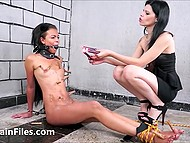Mistress humiliates her guilty black slave girl spanking and dousing her with wax 6