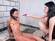 Mistress humiliates her guilty black slave girl spanking and dousing her with wax 9