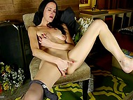 Lonely raven-haired woman feels pleasure masturbating her smooth snatch with gentle fingers 10