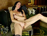 Lonely raven-haired woman feels pleasure masturbating her smooth snatch with gentle fingers 11