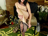 Lonely raven-haired woman feels pleasure masturbating her smooth snatch with gentle fingers 4