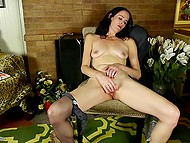 Lonely raven-haired woman feels pleasure masturbating her smooth snatch with gentle fingers 5