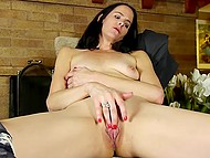 Lonely raven-haired woman feels pleasure masturbating her smooth snatch with gentle fingers 7