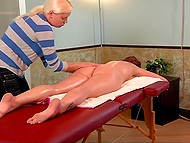 Red-haired colleen relaxes and takes pleasure from gentle movements of masseuse's hands 4
