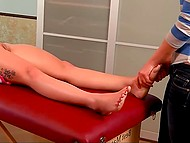 Red-haired colleen relaxes and takes pleasure from gentle movements of masseuse's hands 9