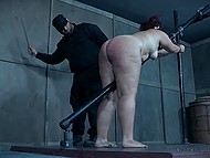 Guy in boilersuit chained helpless fatty woman to handrail and spanked her buttocks with cane 11